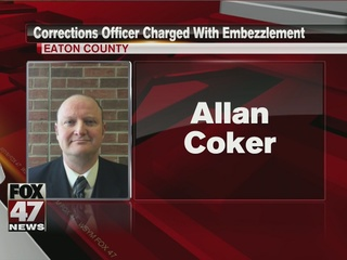 Corrections officer charged with stealing