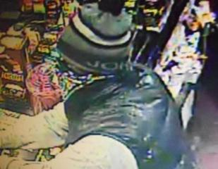 Lansing Police work to identify robbery suspect