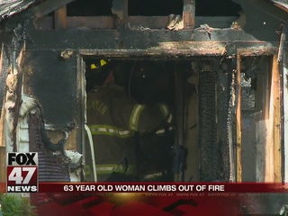 Homeowner climbs out of window, escapes flames