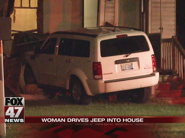 Suspected drunk driver crashes jeep into home