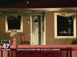 Duplex fire, firefighters suffer from heat