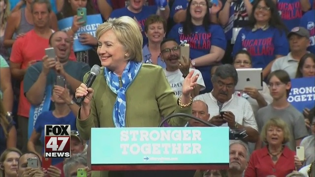 New polls favor Clinton, Trump makes Midwest swing