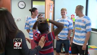 Lansing United players cheer up kids