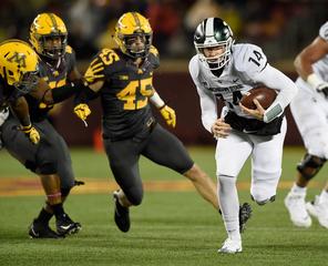 MSU runs over Minnesota, hangs on for 30-27 win