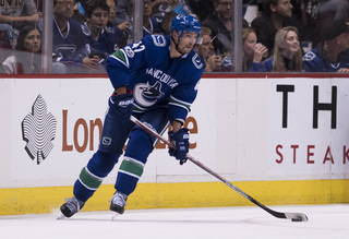 Second period lifts Canucks to win over Detroit