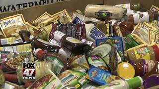 Businesses collect food donations for needy