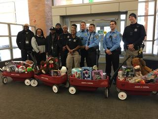 Lansing first responders deliver toys at Sparrow