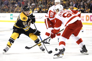 Bruins tie it late, beat Red Wings 3-2 in OT