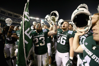 Spartans roll past Cougars 42-17 in Holiday Bowl