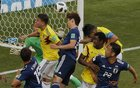 Early penalty helps Japan beat Colombia 2-1