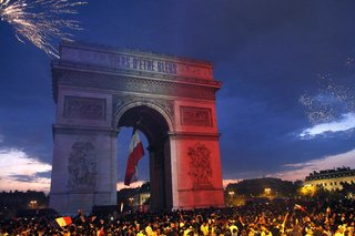 France celebrates with flags, song, pride