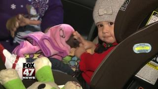 Sparrow installs car seat for local family